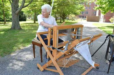 Sister Jean Fuqua weaving at the loom at the 2015 alpaca open house. Come see the alpacas this year on Sept. 25!