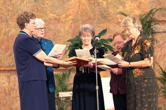Sisters Dawn Tomaszewski (from left), Lisa Stallings, Jeanne Hagelskamp, Mary Beth Klingel and Jenny Howard during the new leadership installation ceremony on Saturday, Sept. 10.