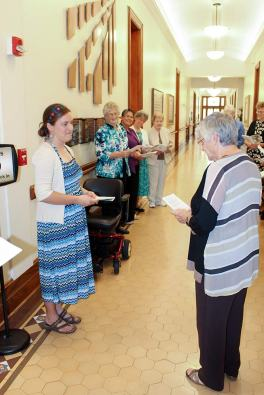 After knocking at the door, Emily is welcomed by General Superior Sister Denise Wilkinson and other members of the Sisters of Providence leadership team and formation team.