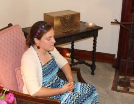 Emily in quiet prayer before the knocking ceremony. (photos by Diane Weidenbenner)