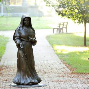 Saint Mother Theodore Guerin statue on a misty morning.