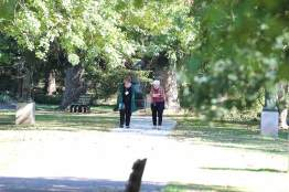 Candidate Ann Henderson and her companion Sister Rosemary Nudd walking and talking.