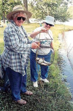 This photo, taken in 2004, depicts Sister Marian Ruth (right) with Sister Mary Pat Peacock (RIP) at St. Joseph's Lake.