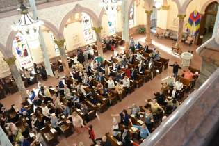 Providence Associates, Sisters of Providence and friends join hands for the Our Father prayer during the Liturgy.