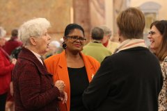 Chatting before the ceremony are, from left, Sister Barbara Reder, Lynda Parker and Joan Richards.