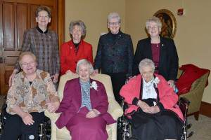 Sisters of Providence 80-year Jubilarians Sister Charles Ellen Turk (front, middle) and Sister Mary Michael Lager (front, right) were honored on Dec. 8, during the annual Senior Jubilee Celebration. They were joined by the General Council, including Sister Mary Beth Klingel (front, left), Sister Dawn Tomaszewski (back, from left), Sister Jeanne Hagelskamp, Sister Lisa Stallings and Sister Jenny Howard.