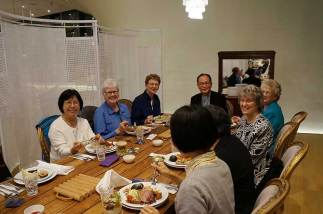 (from left) Sister Norene Wu, Sister Lisa Stallings, Sister Dawn Tomaszewski, Bishop of Taichung Bishop Martin Su, Sister Jenny Howard, Sister Jeanne Hagelskamp and others during a dinner.