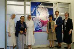 Missionary Sisters of Providence along with Sister Donna Marie Fu, Sister Dawn Tomaszewski and Sister Jeanne Hagelskamp at the entrance to Providence University, which shows Our Lady of Providence.