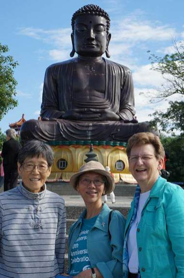 Sister Delan Ma, Sister Sophia Chen and Sister Dawn Tomaszewski sightseeing at a Buddhist Temple.