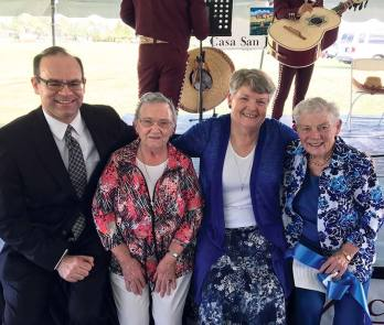 Executive Director of the Florida Catholic Conference Michael Sheedy (from left), Sister Carol Lindly, Sister Jody O'Neil and Sister Cathy Buster at the Casa San Juan Bosco II ribbon cutting on Oct. 4, 2016.