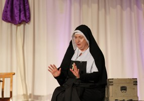 """Following the welcome to everyone, Providence Associate Sandra Hartlieb gives a dramatic portrayal of Saint Mother Theodore Guerin, using quotes from Mother Theodore's Journals and Letters. The hour-long presentation entitled """"In Her Own Words"""" also included music and dance performed by Sandra's sister."""