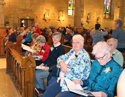 Sisters waiting for the Eucharistic Liturgy to begin at St. Joseph Catholic Church Saturday afternoon, during the 175th anniversary celebration.