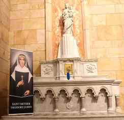 A banner of Saint Mother Theodore Guerin was presented at the front of the church and placed at the left of the alter.