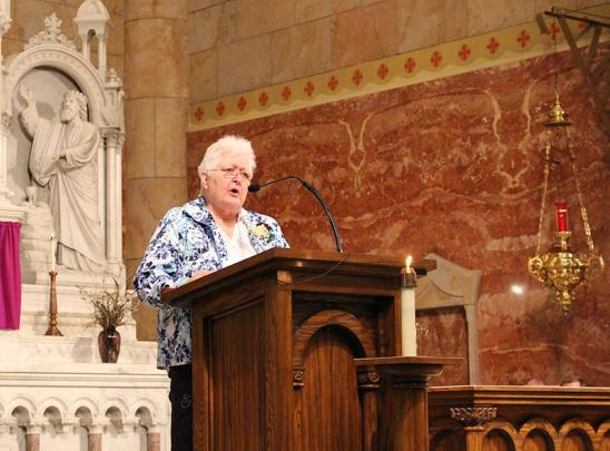 Sister Carolyn Bouchard reads at the celebratory mass.
