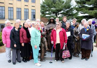 """All Sisters of Providence present joined around the statue at the end of the blessing. They then sang """"Our Lady of Providence"""" in perfect harmony, warming and delighting the crowd. What a special time!"""