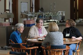 Clockwise from top, Providence Associates Cathy Allen, Teresa Clark and Sara Bennett visit with Sister Rita Clare Gerardot, at left, during one of the breakout sessions.