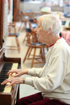 Sister Joan Matthews plays the piano and sings with the breakout session that got together and made music.