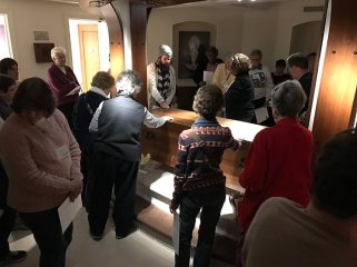 Providence Associates and sisters keep vigil with Saint Mother Theodore Guerin at her shrine on Saturday night.