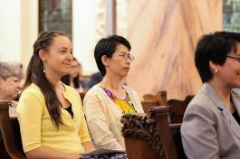 Sisters Tracey Horan and Anna Fan, who are making first vows, listen to Sister Dawn's reflection.