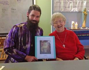 Ezra Meadors, left, dedicated his internship project, a prayer service for interns, to Sister Barbara Doherty, right.