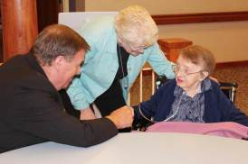 Archbishop Tobin greets Sister Catherine Arkenberg along with Sister Lisa Stallings.