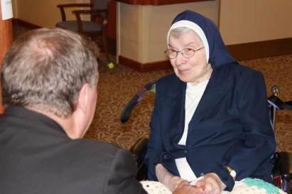 Archbishop Tobin has a conversation with Sister Rosalie Weller.