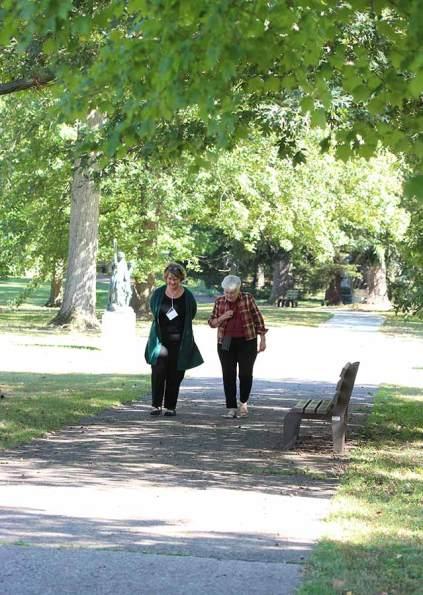 Providence Associate Ann Henderson walks and talks with her Providence Associate companion Sister Rosemary Nudd.