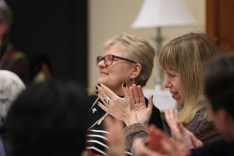 Providence Associate Mel Marino Wolff joins others in applauding the announcement of Sister Sue Paweski, backset, as the new co-director for the Providence Associate relationship.