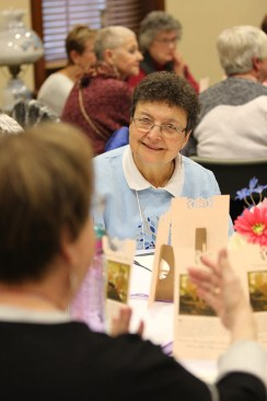 Providence Associate Marilyn Rausch listens during table discussion.