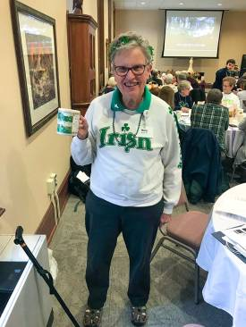 Showing of her St. Patrick Day spirit on Saturday at the retreat is Sister Mary Moloney.