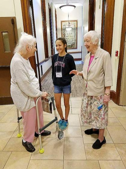 Sister Charles Van Hoy (left) and Sister Joan Matthews chat with 2017 volunteer, Trinity Miranda. Trinity, 14, is the daughter of Amy and Martin Miranda, Terre Haute.