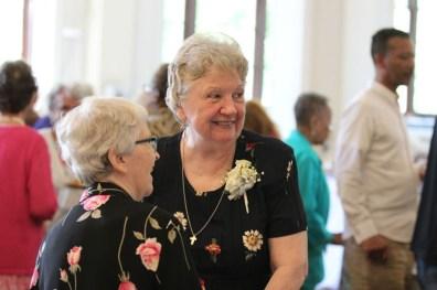 25 year Jubilarian Sister Pat Linehan greets a sister at the reception.