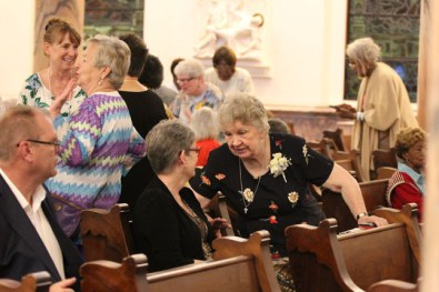 Sister Patricia Linehan chats with a guest before Mass.