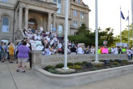 Sisters and associates join the peaceful protest to keep families together at the Vigo County courthouse. Here Sisters Joni Luna and Barbara Battista speak in front of the crowd.