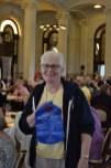 Sister Cynthia Lynge shows off her toilet tank bank, a prize from winning environmental bingo.