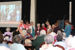 Honoring and blessing sisters and ministries completing their missions this year. From left, General Officer Sister Lisa Stallings, Sister Mary Tomlinson of Guerin Outreach Ministries, General Officer Sister Jeanne Hagelskamp, Sister Loretta Picucci of Providence in the Desert, Sister Kathleen Desautels of Eighth Day Center for Justice, General Officer Sister Jenny Howard, Sister Carol Nolan of Providence in the Desert and General Officers Sisters Mary Beth Klingel and Dawn Tomaszewski.