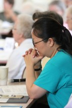 Postulant Teresa Kang during a prayer moment at the annual meeting.