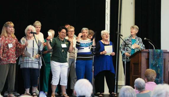 Sisters and associates perform a song parody at the Sunday social. From left, Providence Associates Mel Marino Wolff, Sheila Donis, Jan Surber (back), Sisters Dina Bato, Sue Paweski (back), Terri Grasso, Providence Associate Diann Neu and Sister Mary Montgomery.