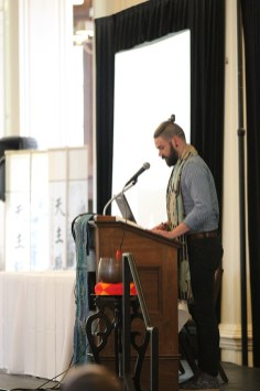 Providence Associate Ezra Kyle Meadors reads during a reflective time at the joint meeting with the sisters on Monday.