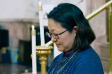 Sister Kang prays during her entrance to the novitiate ceremony