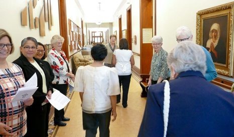 General Superior Sister Dawn Tomaszewski and members of the General Council, New Membership ministry and sisters in formation greet Jessica as she enters Providence Hall.