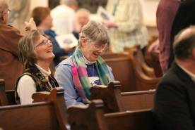 Providence Associate Candidate Kathy Shickles visits with Sister Mary Montgomery before the blessing.