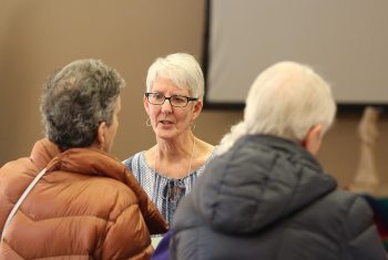 Providence Associate Candidate Carol Sloan gets to know other candidates at the orientation