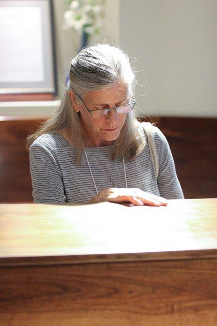Providence Associate Joan Richards prays in the Shrine of Saint Mother Theodore Guerin.