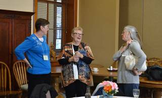 Providence Associate co-director Sister Sue Paweski, center, laughs with Candidate Debbie Fornefeld and her companion Providence Associate Joan Richards.