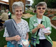 Sister Elizabeth (Betty) Koressel, right, enjoys ice cream with Sister Jane Gibson on a recent outing for retired sisters at the Woods.