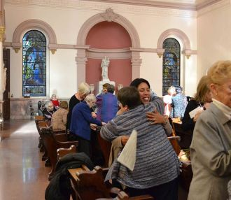 New Providence Associate Sharon Rodriguez receives a hug of congratulations from Sister Jane Iannaconne