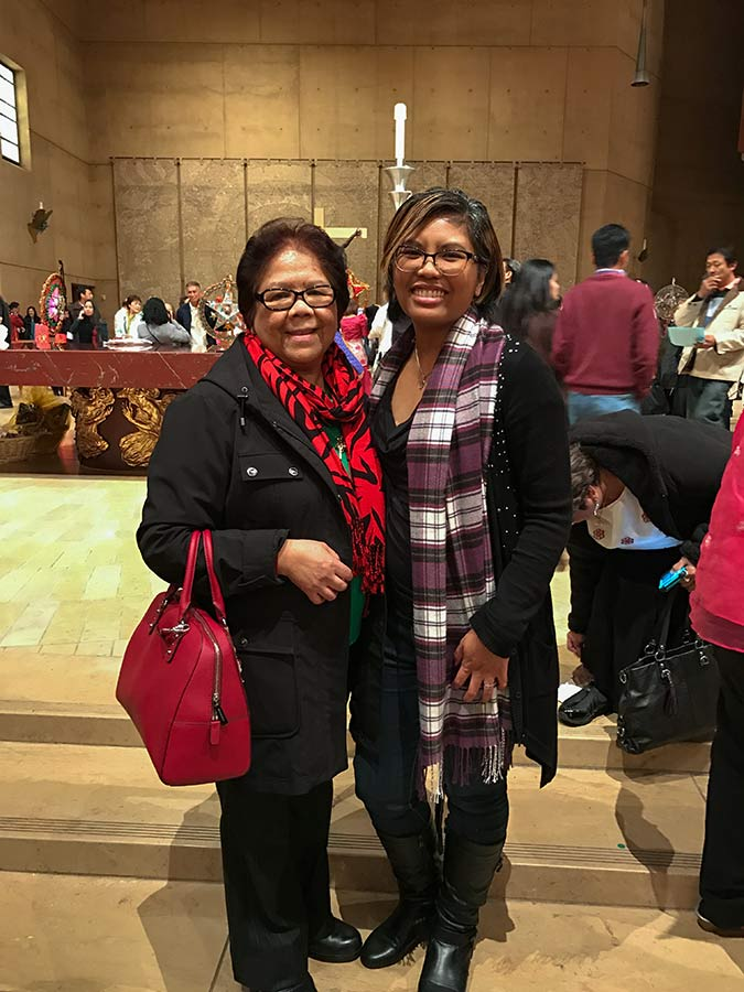 Postulant Jessica Vitente, right, with her mother at a past Simbang Gabi celebration.