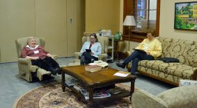 A nice place to relax on a rain-filled retreat day: the recliners and the couch in the community room. From left, Providence Associates Lenore Renier, Jenny Nowalk and Donna Watzke