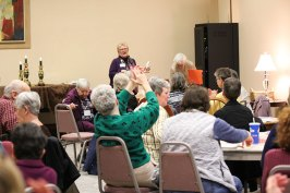 Attendees clap as Sister Sue Paweski introduces Sister Dianne Bergant, C.S.A., retreat leader.
